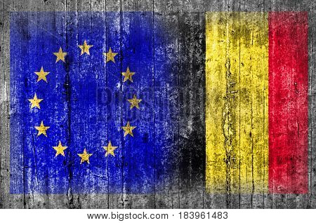 EU and Belgium flag on concrete wall