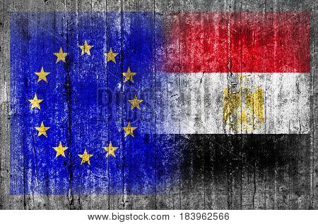 EU and Egypt flag on concrete wall