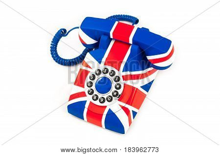 Photo of Union Jack telephone with pattern of British flag isolated on the white background. Union Jack telephone with pattern of Great Britain flag. Isolated on white background. Top view.