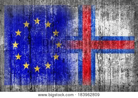 EU and Faroe Islands flag on concrete wall