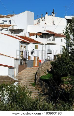 Townhouses along a stepped village street El Burgo Malaga Province Andalusia Spain Western Europe.