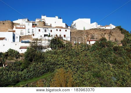 View of the village on the hill showing part of the old village wall El Burgo Malaga Province Andalusia Spain Western Europe.