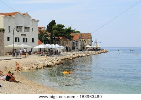 PRIMOSTEN, CROATIA - SEPTEMBER 10, 2016: This is the embankment of a small old Croatian seaside resort town.