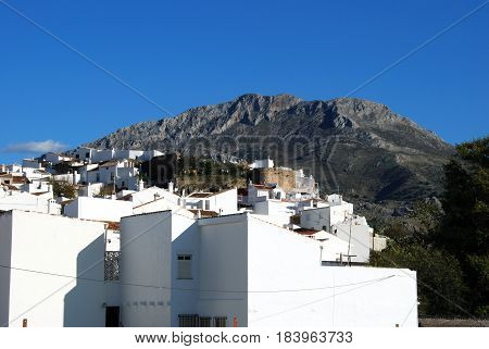 View of village buildings with mountains to the rear El Burgo Malaga Province Andalusia Spain Western Europe.
