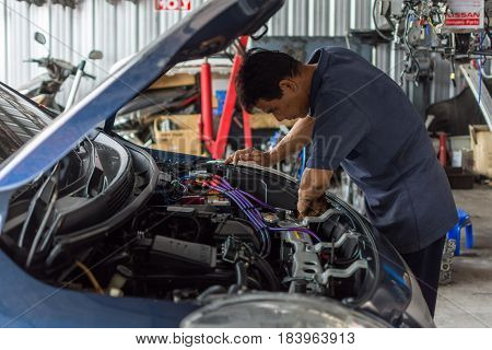 Checking A Car Engine For Repair At Car Garage