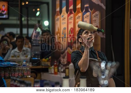 Bartender Mixing A Drink At Restaurant