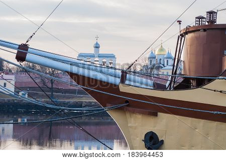 Veliky Novgorod Russia.Architecture spring evening landscape - Veliky Novgorod Kremlin fortress and St Sophia cathedral on the bank of the Volkhov river with bow of the frigate ship with rigging on the foreground