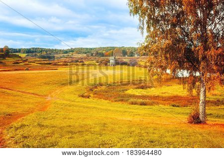 Autumn cloudy rural landscape with autumn colorful view of Soroti river valley - autumn natural landscape of autumn nature and yellowed autumn forest in cloudy autumn weather. Soft focus applied. Landscape view of autumn valley