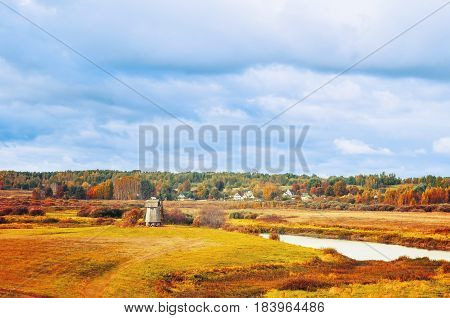Autumn landscape with autumn view of Soroti river valley and yellowed autumn forest in Pushkinskiye Gory Russia -autumn natural landscape of autumn nature in cloudy autumn weather. Autumn nature.Soft focus applied