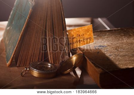 Sign Life is an adventure concept photo with vintage books - Vocation background