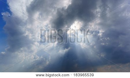 Beautiful sunray , rain clouds and part of blue sky background