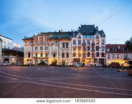 KRAKOW POLAND - JUNE 17 2016: Plac Szczepanski Square and The Old Theater in the evening in Cracow Poland.
