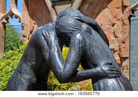 COVENTRY, UNITED KINGDOM - JUNE 4, 2015 - Reconciliation statue inside the ruins of the old Cathedral Coventry West Midlands England UK Western Europe, June 4, 2015.