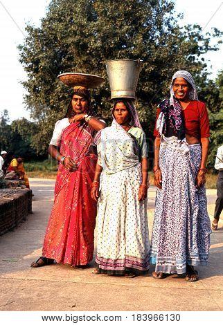 DELHI, INDIA - NOVEMBER 20, 1993 - Three Indian women wearing saris in the city Delhi Delhi Union Territory India, November 20, 1993.