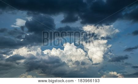 Mixing thunderclouds and white clouds in the sky background