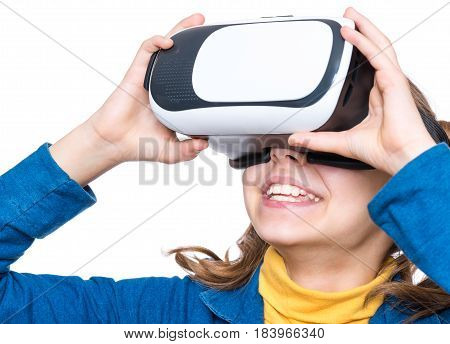 Happy little girl wearing virtual reality goggles watching movies or playing video games. Cheerful smiling kid looking in VR glasses. Funny child experiencing 3D gadget technology - close up.