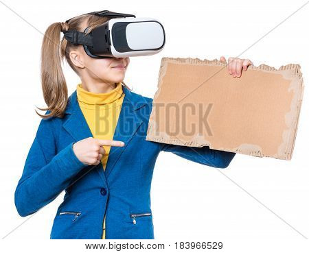 Happy little girl wearing virtual reality goggles watching movies or playing video games. Kid with VR glasses and corrugated cardboard torn pieces. Funny child experiencing 3D gadget technology.