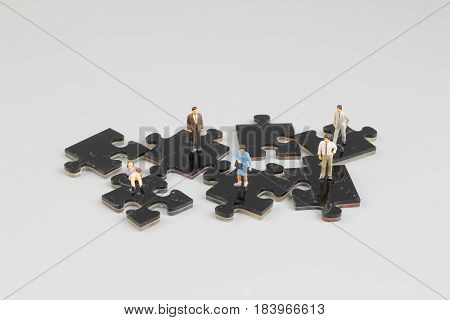 Business People Collaborate Holding Up Jigsaw Puzzle Pieces