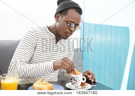 People, Food, Leisure And Lifestyle Concept. Handsome Fashionable Afro American Guy In Trendy Eyewea