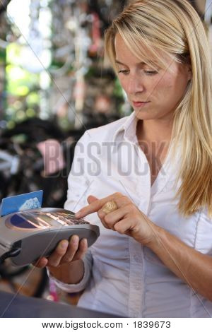 Woman Using Debit Machine