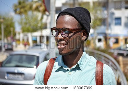 Close Up Shot Of Handsome Black European Hipster With Backpack Walking Around Metropolis, Exploring