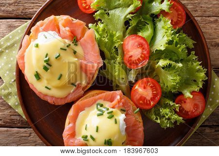 Eggs Benedict With Salmon And Hollandaise Sauce Close-up. Horizontal Top View