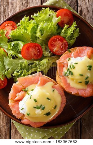 Eggs Benedict With Salmon And Hollandaise Sauce Close-up. Vertical Top View