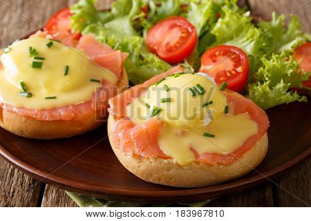 Eggs Benedict With Salmon And Hollandaise Sauce Close-up. Horizontal