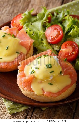 Delicious Breakfast: Eggs Benedict With Salmon And Hollandaise Sauce Close-up. Vertical