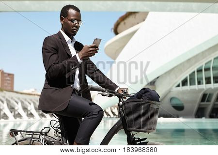 Side View Portrait Of Modern Ecologically Conscious Afro American Banker Commuting To Work On Bicycl