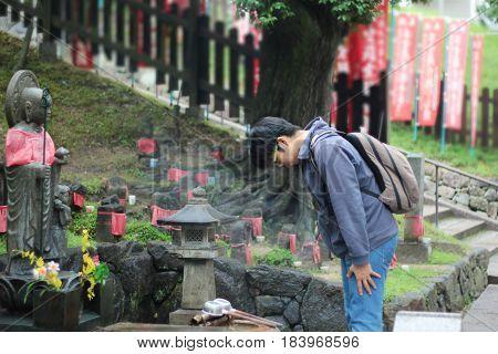 Tourists homage to the spirit of faith after pour water to Buddha at Kofukuji temple Nara Japan