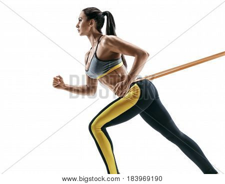 Attractive sporty girl during workout with suspension straps isolated on white background. Strength and motivation