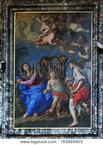 ROME, ITALY - SEPTEMBER 02: The Holy Family with angels and symbols of the passion by Bernardino Mei, Church of Santa Maria del Popolo, Rome, Italy on September 02, 2016.