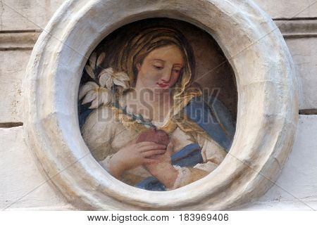 ROME, ITALY - SEPTEMBER 01: Image of Virgin Mary on the facade of a palace in Rome, Italy on September 01, 2016.