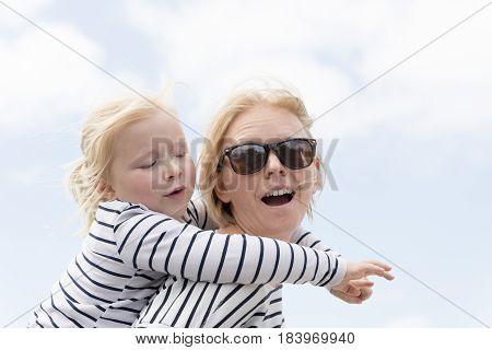 Mom Gives Little Girl A Piggy Back Ride