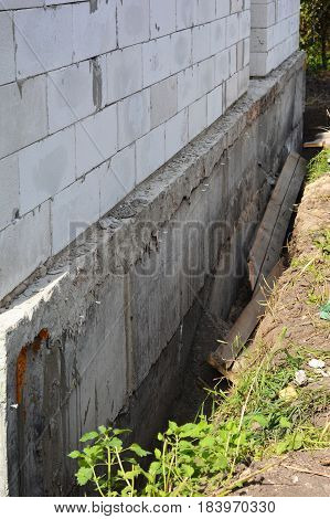 House Construction without Waterproof Basement Walls From Exterior. Foundation insulation and waterproofing
