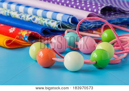 Scrapbooking craft materials on bright blue background
