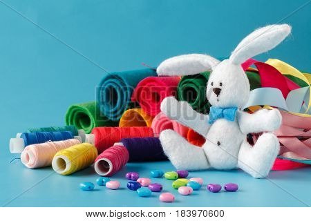 Spools of thread and sewing tools with toy