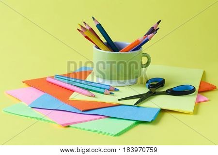 School Supplies, Pen, Paper On A Yellow Background