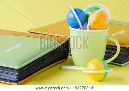 Baby photo album with rattle in cup