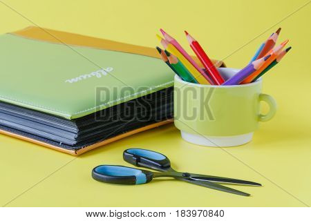 album wedding book with pen in cup