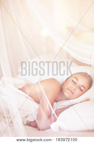 Pretty female sleeping at home in the bed under beautiful transparent valance, peace and relaxation, healthy luxury lifestyle