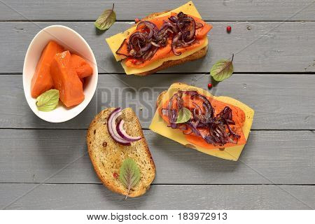 Bruschetta with roasted pumpkin cheese and fried onions, top view