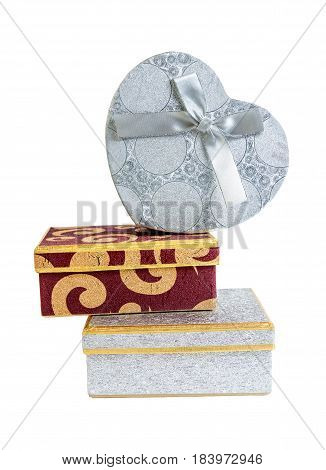 Silver and red gift boxes isolated on white background