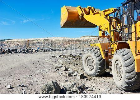 wheel loader excavator at granite or iron ore opencast mine