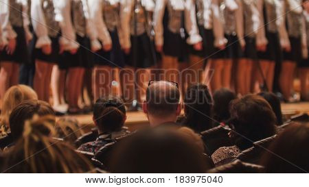 legs in pantyhose of girl - children choir - rehearsal of Academic Song, telephoto
