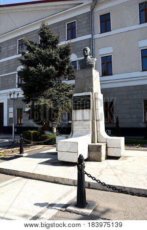 Statue. Typical urban landscape in the city Cluj-Napoca, continuing the old antic roman town Napoca, Transylvania, Romania