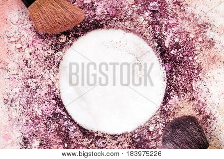 A closeup of makeup brushes on a white marble background, with traces of powder and blush forming a frame. A horizontal template for a makeup artist's business card or flyer design, with copy space