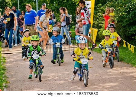 Russia. Moscow. Vorontsovsky Park on the 21st of August. STRIDER CUB 2016. Children started at competitions on races on balance bike