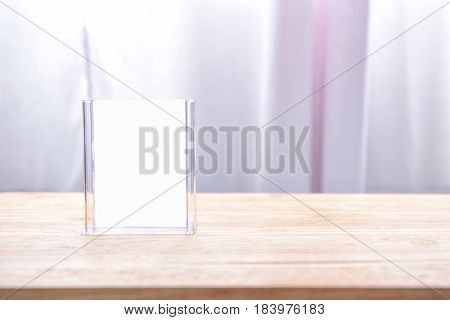 Close up of Table tent on wooden table